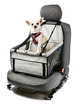 Car Seat Dog Cradle - This dog cradle folds flat so that you can keep it in the car at all times. It takes minutes to attach to any seat and features an integral safety strap that will clip onto any dog harness to keep your dog safe and secure throughout the journey. The cradle features support bars around the three side...